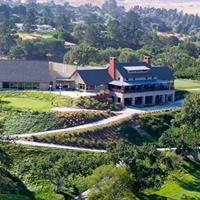 An aerial view of the Corral de Tierra Country Club Farmhouse Style Clubhouse sitting upon the hilltop above the course. Great views of the golf course and surrounding hills can be enjoyed in the Grill Room and Roberto's Bar.