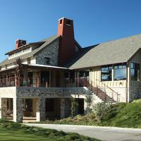 View of the Corral de Tierra farmhouse-style clubhouse veranda, bar and fitness center.