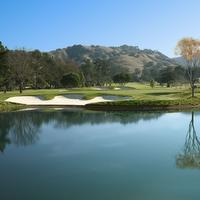 View of the championship golf course, lake and rolling hills in the beautiful sunny weather setting of the Corral de Tierra Country Club on the Monterey Peninsula.